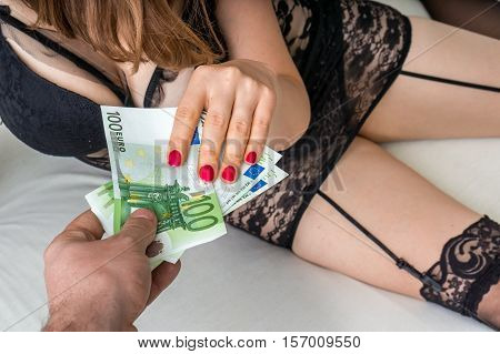 Man Paying Prostitute For Sex