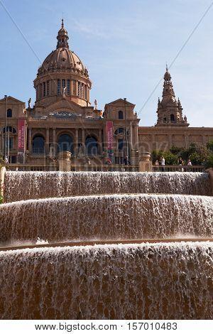 BARCELONA, SPAIN - SEP 13, 2016: Tourists gather in front of the National Museum of Art above the water feature.