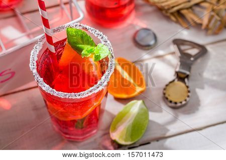 Cold Summer Drink With Citrus Fruit On Old White Table