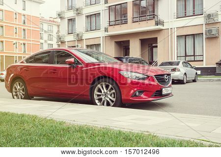 Sochi, Russia - October 11, 2016: New red Mazda 6 (Atenza) parked on the street of Sochi. The Mazda 6 has sold over one million units worldwide since its introduction hitting this sales milestone faster than all previous Mazdas.