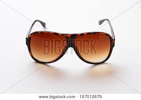 Leopard-rim sunglasses on white background