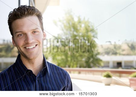 Attractive business man outside an office building