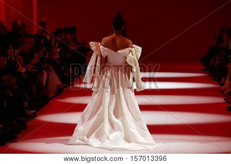KYIV, UKRAINE - OCTOBER 13, 2016: Model walks the runway at Datuna collection show during the 39th Ukrainian Fashion Week at Mystetsky Arsenal in Kyiv