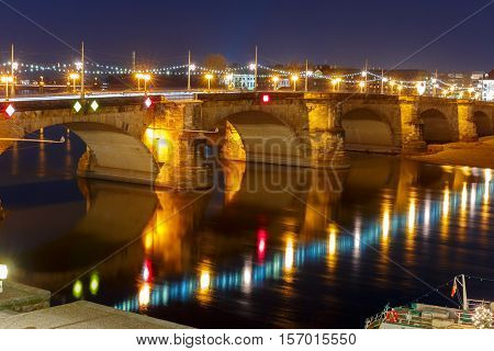 Augustus Bridge with reflections in the river Elbe at night in Dresden, Saxony, Germany