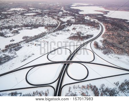 winter road junction in the countryside aerial view  in the form of butterfly
