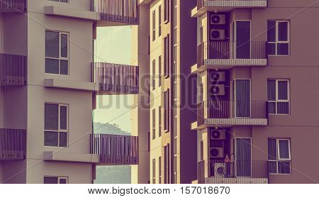 vintage tone image of Modern Luxury apartments (condo) on day time for background usage.