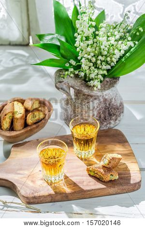 Delicious Cantucci With Vin Santo On Old Wooden Table