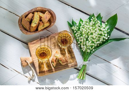 Delicious Biscotti With Vin Santo On Old Wooden Table