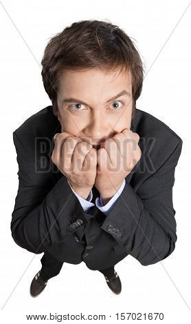Young Businessman Standing and Biting his Nails - Isolated