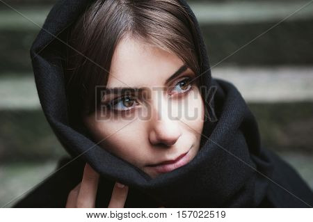 Young woman with headscarf, veiled, looking side.