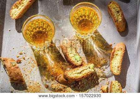 Italian Cantucci With Vin Santo On Old Wooden Table