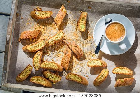 Italian Cantucci With Espresso On Old Wooden Table