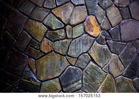 An image of a mosaic stone wall.