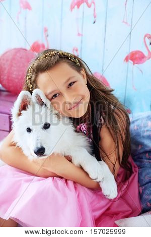child hugging a dog in the room. The concept of friendship and lifestyle.