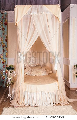 four-poster bed in the room in studio