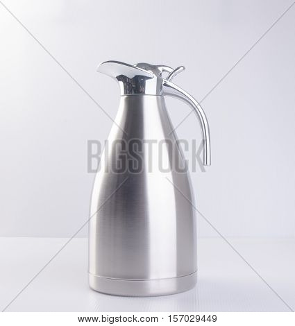 Thermo Or Thermo Flask From Stainless Stee On Background.