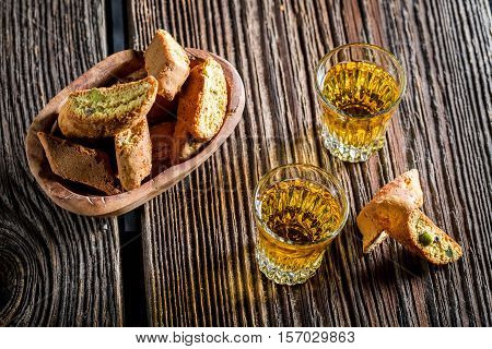 Crispy Cantucci With Vin Santo On Old Wooden Table