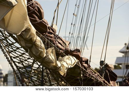 bowsprit of the sailing ship against blue sky