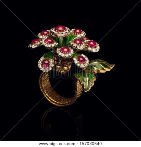 Close up of beautiful Diamond Ring , with many different precious Gemstone over black background