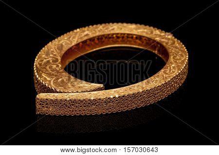 Diamond bracelet with many stones on reflective black background