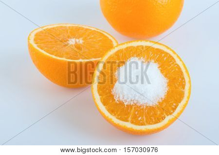 Orange fruit round slice with salt on white background
