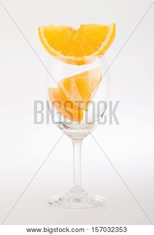 Fresh orange in glass on white background