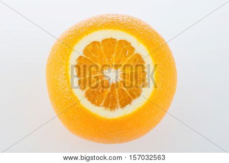 Fresh orange and cut in half on white background