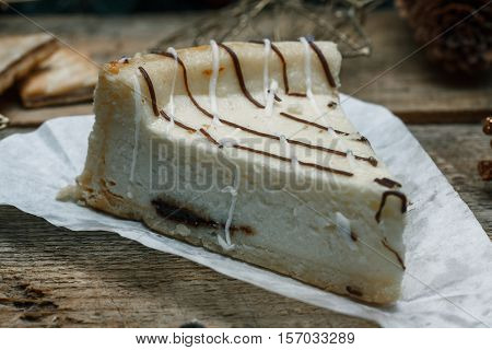 Beautiful Homemade Cake Cheesecake On A White Paper On The Wooden Background. Next Chocolate Chip Co