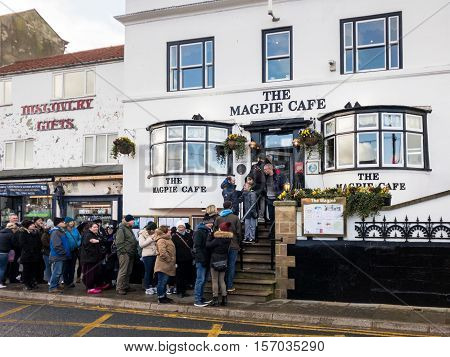 WHITBY ENGLAND - NOVEMBER 5: People queuing outside famous Magpie Cafe. In Whitby North Yorkshire England. On 5th November 2016.