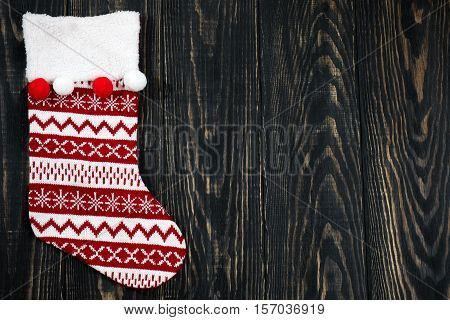 Christmas Red Sock On A Wooden Background