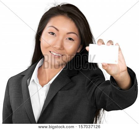 Friendly Asian Businesswoman Holding a White Placeholder - Isolated