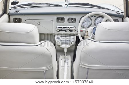 White covertible leather saloon, view from the back seat