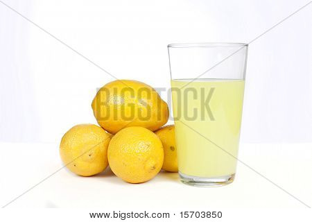 Glass of lemonade with lemons