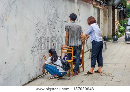 Painting The Walls In Guilin, China