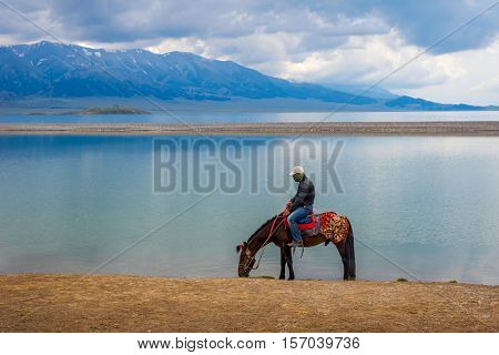 Horse Rider By Sayram Lake, China