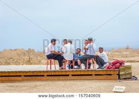 Group Of Local Uyghur Man Talking, China