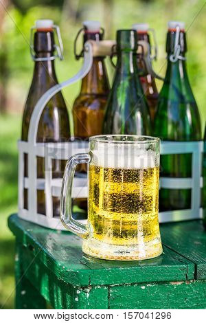 Cold Lager Beer In Garden On Old Wooden Table