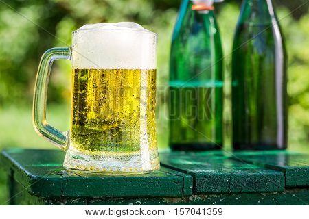 Fresh Beer In Garden On Old Wooden Table