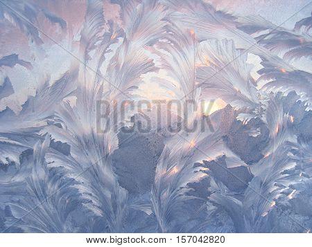Beautiful ice pattern and sunlight on winter glass