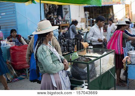 Aymara native woman selling popcorn at the market in Sucre Bolivia. October 5 2012 - Sucre Bolivia