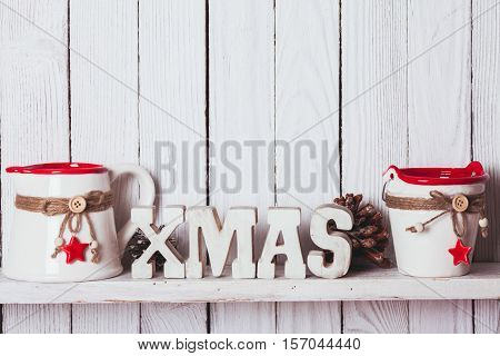 Christmas decor on the shelf - wooden letters XMAS in the kitchen