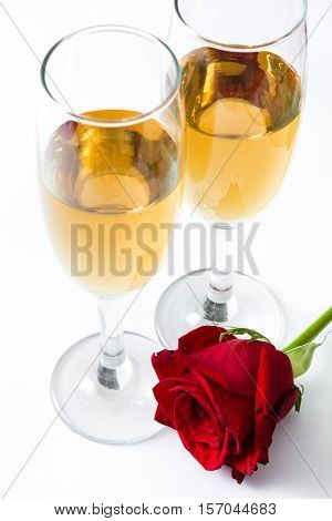 Champagne cups and rose isolated on white background