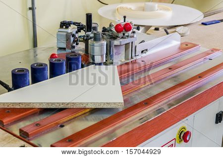 production of furniture, edging detail on edge banding machines