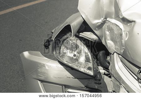 Car Crash Background. Car After Collision With Another Car With Damaged Front.