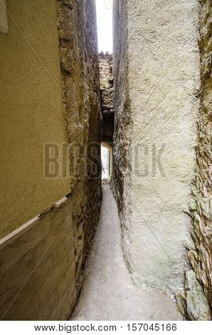 Klancic the narrowest street in the world in Vrbnik town Krk island Croatia. Only 43cm wide stone medieval traditional Mediterranean architecture alley in the historic town.