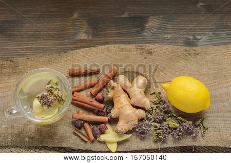 Ginger tea with lemon herbs and cinnamon alternative treatment for cold and flu