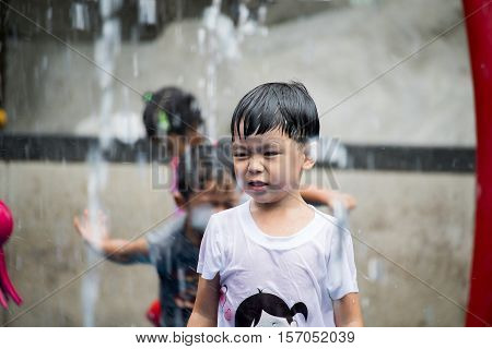 Boy playing in water park. Boy have fun in water park.