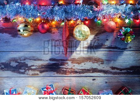 close up view of christmas tree toys and gifts on wooden back
