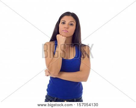 young beautiful hispanic woman in casual top and jeans looking lost and confused worried and thoughtful isolated on white background