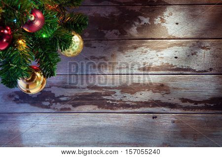 close up view  of  decorated Christmas tree on wooden back